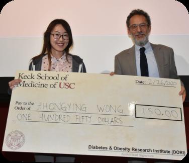 Award being presented to Zhongying Wong