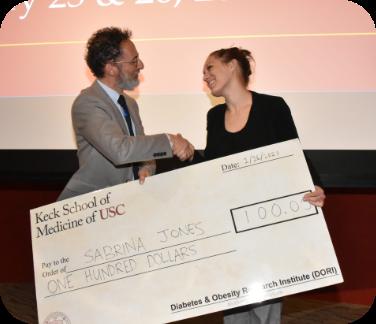 Award being presented to Sabrina Jones